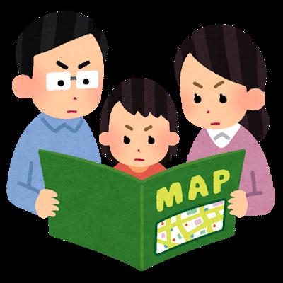 地図を見る家族